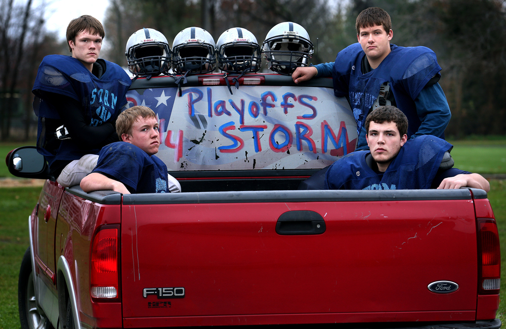 Sangamon Valley teammates, all seniors from Buffalo Tri-City, gather for a portrait in the pickup truck decorated with a playoff sign owned by team member Ty Summer before practice in Illiopolis on Tuesday, Nov. 4, 2014. From left to right: Jacob Poorman, Cody Craven, Andy Goldstein (front right) and Ty Summer. David Spencer/The State Journal-Register