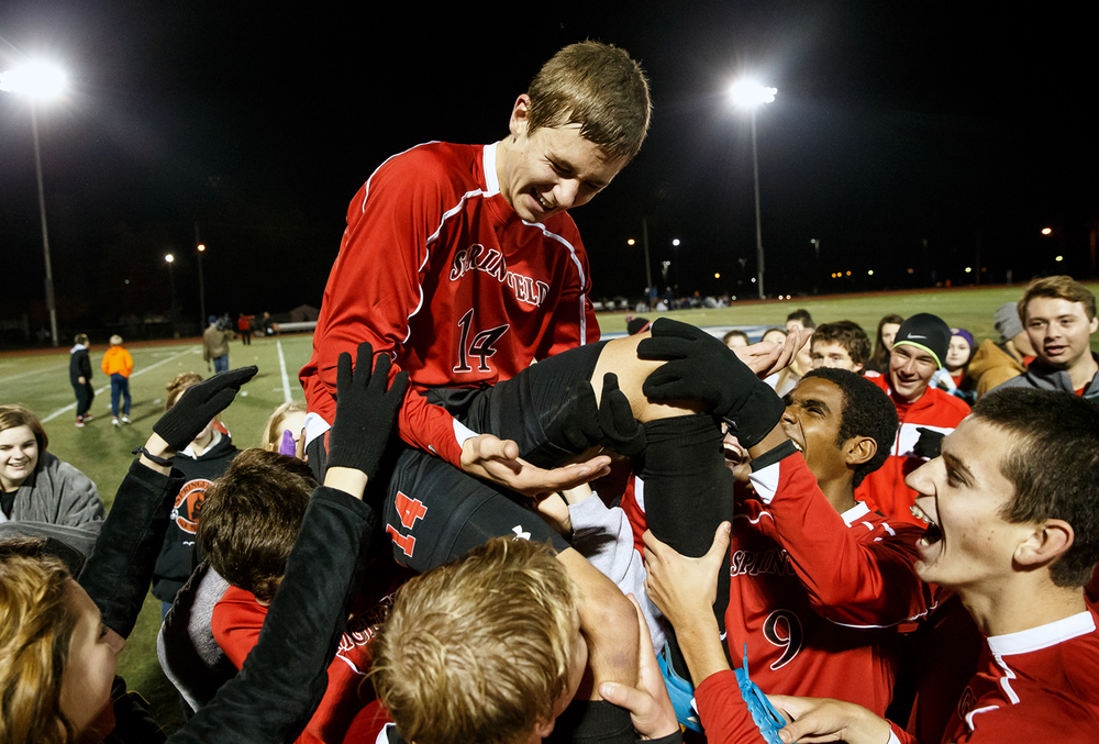 Springfield's Colin Tierney (14) is hoisted by the fans and his teammates after the Senators defeated Rochester 2-1 during a Class 2A soccer supersectional at Illinois College, Tuesday, Nov. 4, 2014, in Jacksonville, Ill. Justin L. Fowler/The State Journal-Register