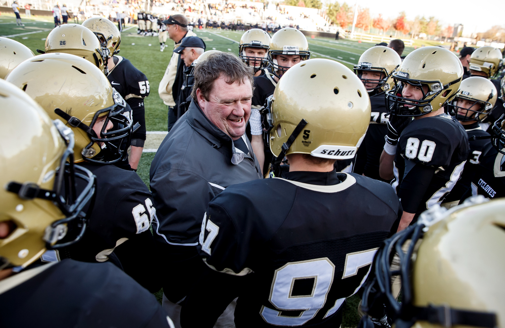 Sacred Heart-Griffin special teams coach Neal Taylor congratulates Conner McEvoy (97) on his fumble recovery against Marion in the second half during the second round of the Class 5A playoffs at the SHG Sports Complex, Saturday, Nov. 8, 2014, in Springfield, Ill. Justin L. Fowler/The State Journal-Register