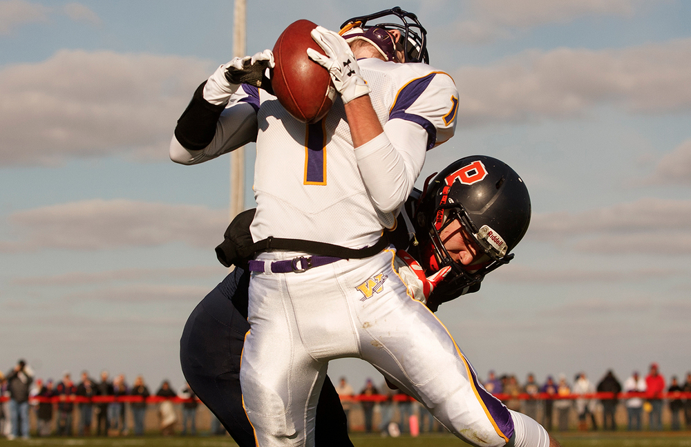 New Berlin's Cam Cummings slams into Williamsville's Daniel Daykin in the first half during the Class 3A high school football playoffs at New Berlin Saturday, Nov. 8, 2014. Ted Schurter/The State Journal-Register