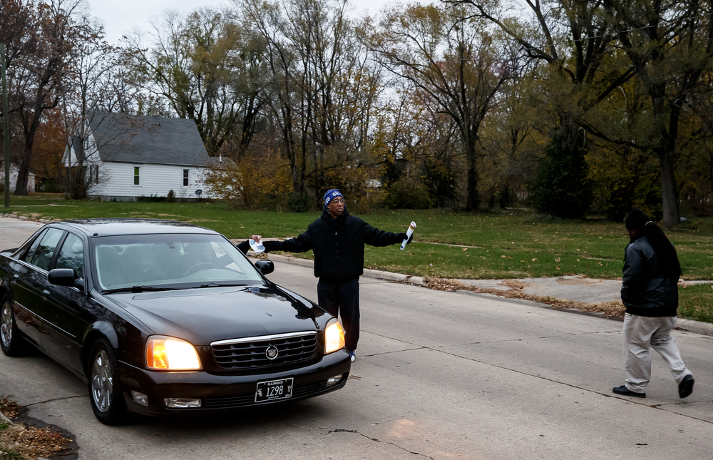 Pastor Donald Mayes hands out a stop the violence flier to a passing car as he marches during the Stop the Violence Walk for Peace & Prayer Vigil in response to the murder of Kirk Hardy, Tuesday, Nov. 11, 2014, in Springfield, Ill. Justin L. Fowler/The State Journal-Register