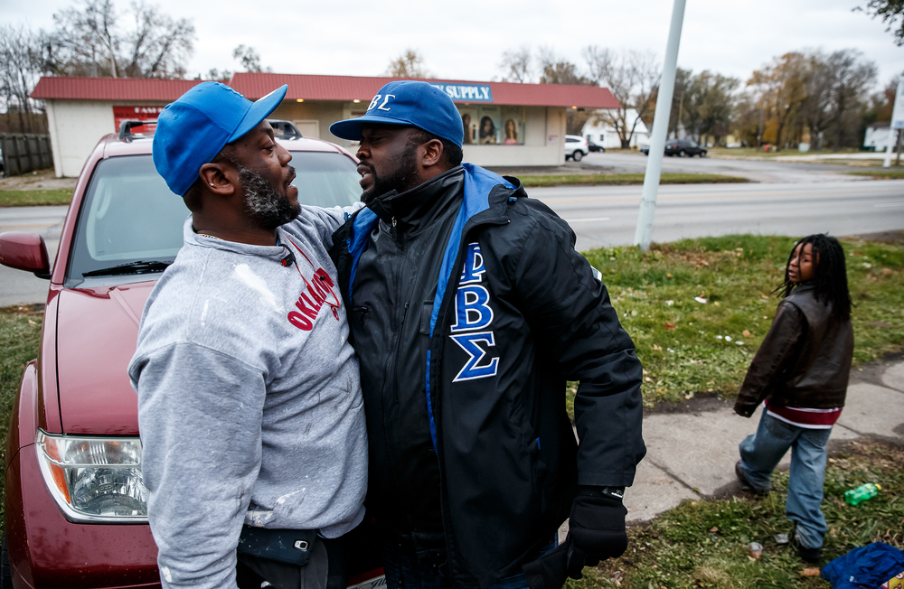 "Ardell Hampton, left, gives Larry Hemingway Sr., right, a hug as he greets him along the Stop the Violence Walk for Peace & Prayer Vigil in response to the murder of Kirk Hardy, Tuesday, Nov. 11, 2014, in Springfield, Ill. ""That's like one of the biggest mentors of this community for the young folks,"" said Hampton of Hemingway. Justin L. Fowler/The State Journal-Register"