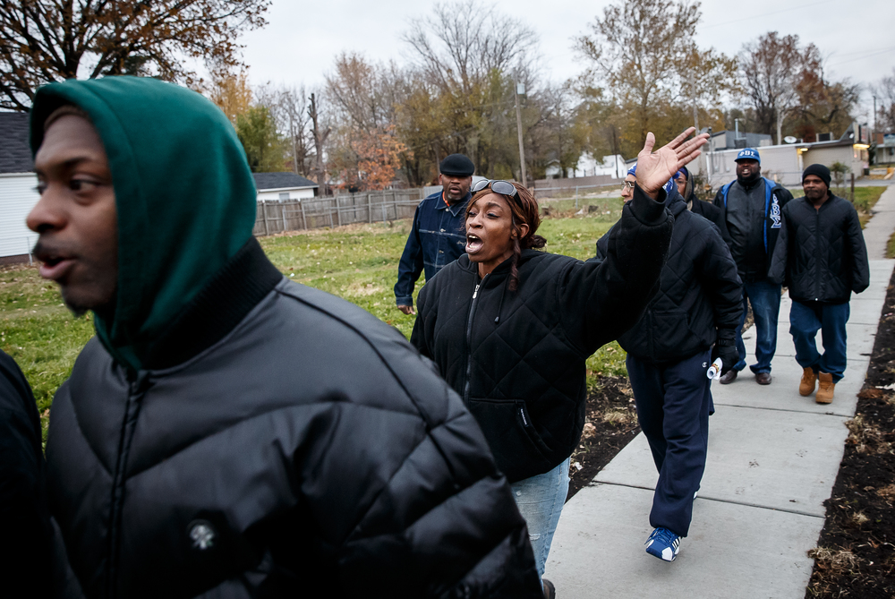 "Jodi Andrews, chants ""Please don't kill me, I want to live!"" while marching along Martin Luther King Jr. Drive during the Stop the Violence Walk for Peace & Prayer Vigil in response to the murder of Kirk Hardy, Tuesday, Nov. 11, 2014, in Springfield, Ill. Justin L. Fowler/The State Journal-Register"