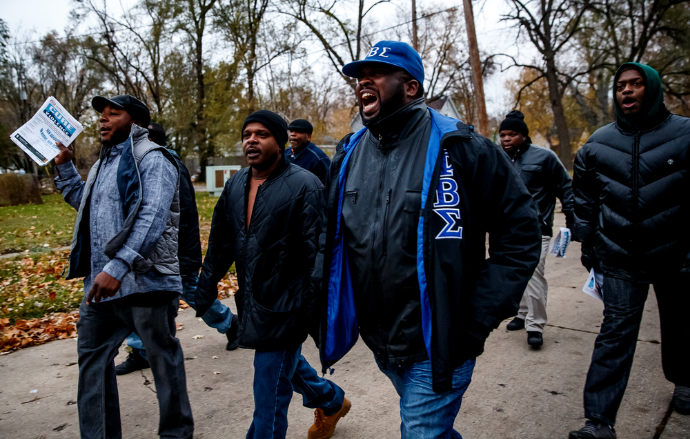 "Larry Hemingway Sr., center, program manger for the Springfield Urban League, shouts out ""I don't know what you've been told, bullies kill both young and old!"" during a peace walk in response to the murder of Kirk Hardy, Tuesday, Nov. 11, 2014, in Springfield, Ill. Justin L. Fowler/The State Journal-Register"
