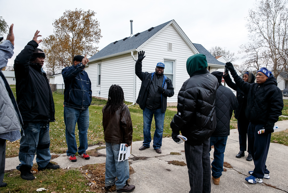 Larry Hemingway Sr., center, program manager at the Springfield Urban League, asks for those in attendance to raise their hand if they've lost someone to gun violence during the Stop the Violence Walk for Peace & Prayer Vigil in response to the murder of Kirk Hardy, Tuesday, Nov. 11, 2014, in Springfield, Ill.   Read more.   Justin L. Fowler/The State Journal-Register