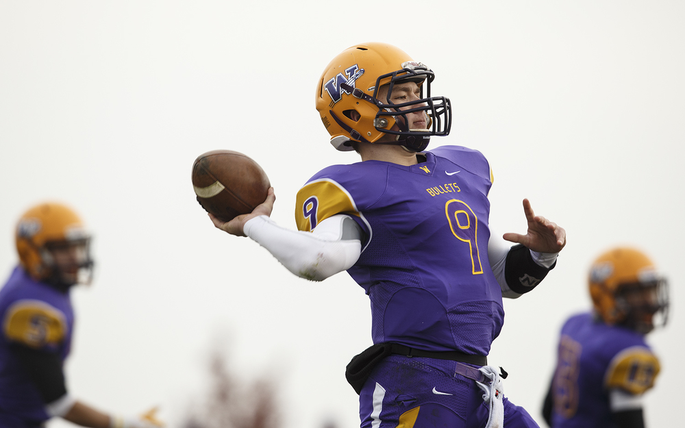 Williamsville quarterback Luke Bleyer fires a pass against Auburn during the Class 3A high school football playoffs in Williamsville Saturday, Nov. 15, 2014. Ted Schurter/The State Journal-Register