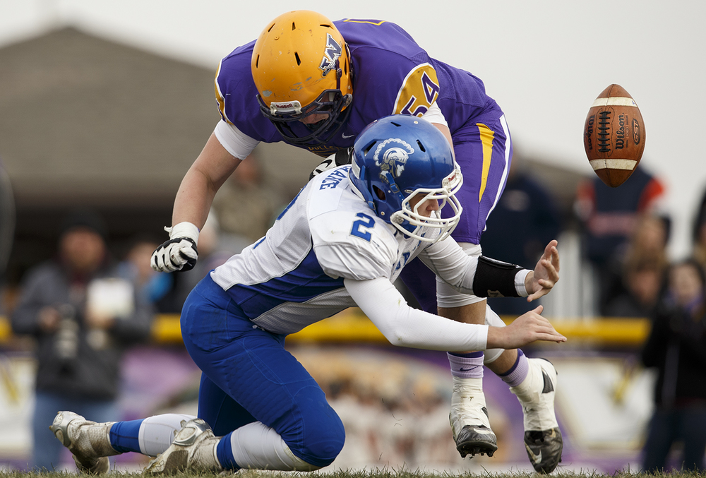 Williamsville's Mitch Whitley closes in on Auburn quarterback Drew Chance as he scrambles for a fumbled ball during the Class 3A high school football playoffs in Williamsville Saturday, Nov. 15, 2014. Ted Schurter/The State Journal-Register