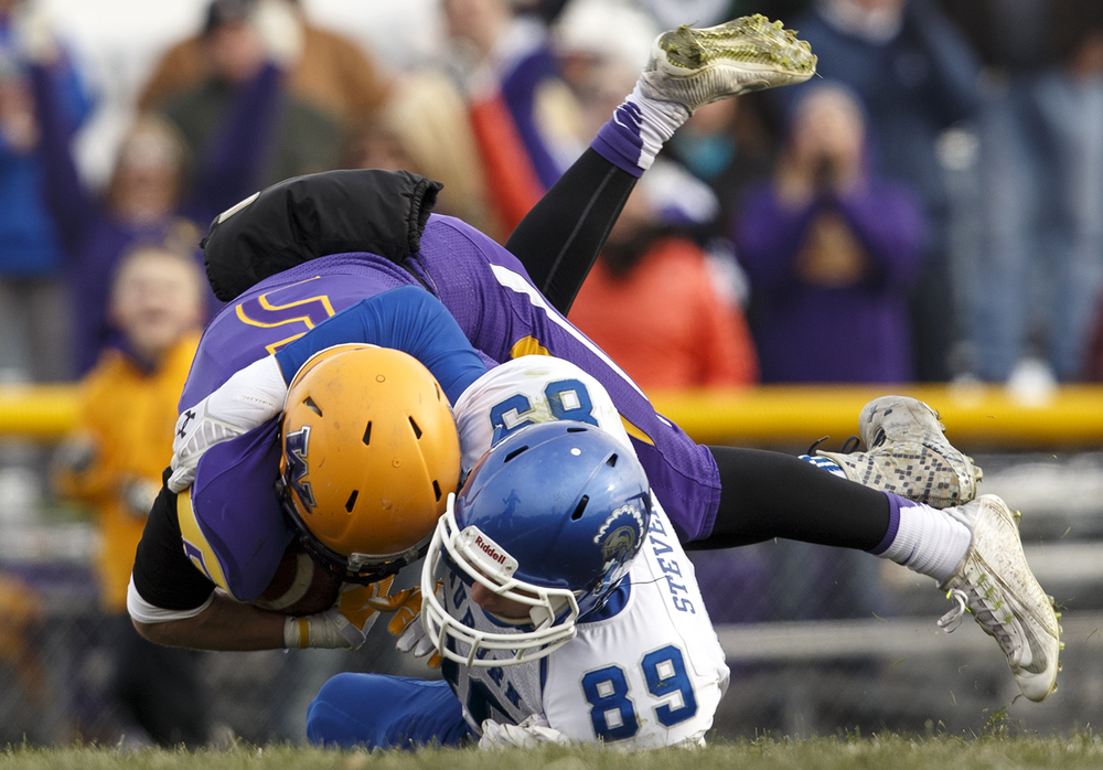 Auburn's Everett Stevens brings down Williamsville's Vince Vignali during the Class 3A high school football playoffs in Williamsville Saturday, Nov. 15, 2014. Ted Schurter/The State Journal-Register