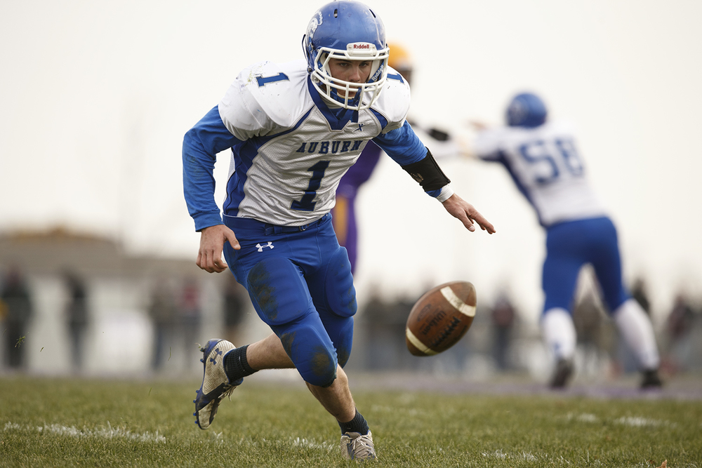 Auburn's Caleb Putman runs down an onside kick against Williamsville during the Class 3A high school football playoffs in Williamsville Saturday, Nov. 15, 2014. Ted Schurter/The State Journal-Register