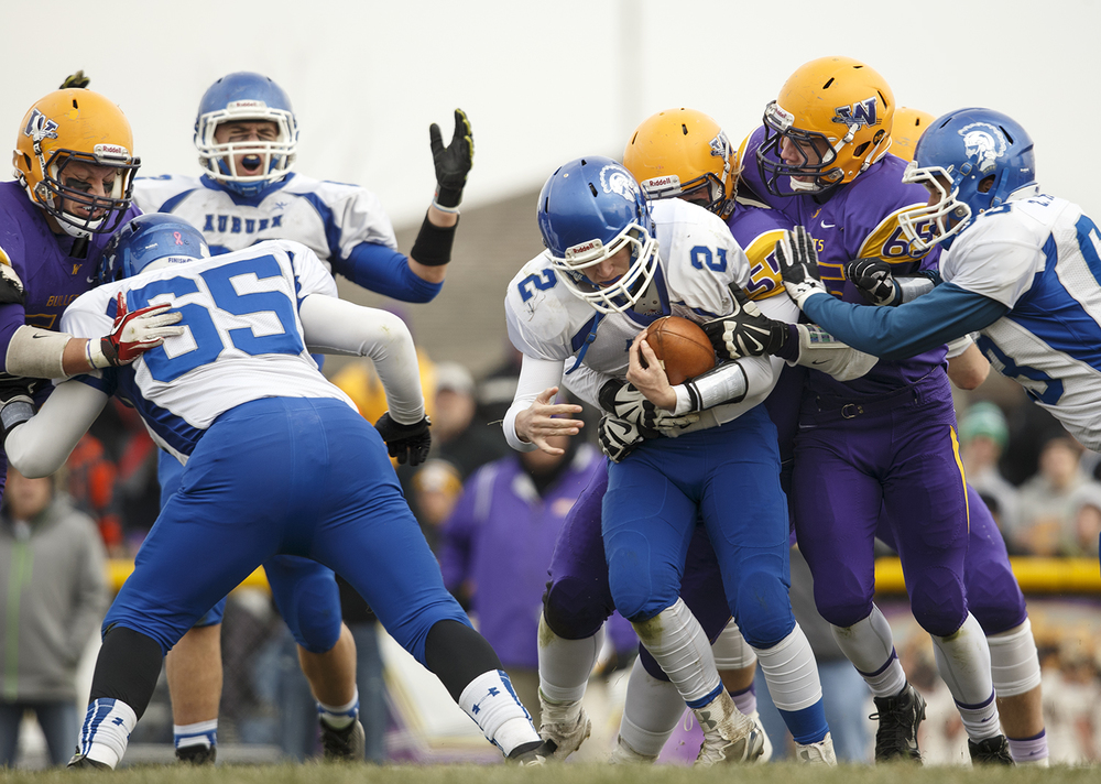 Auburn's Drew Chance is sacked by the Williamsville defense during the Class 3A high school football playoffs in Williamsville Saturday, Nov. 15, 2014. Ted Schurter/The State Journal-Register