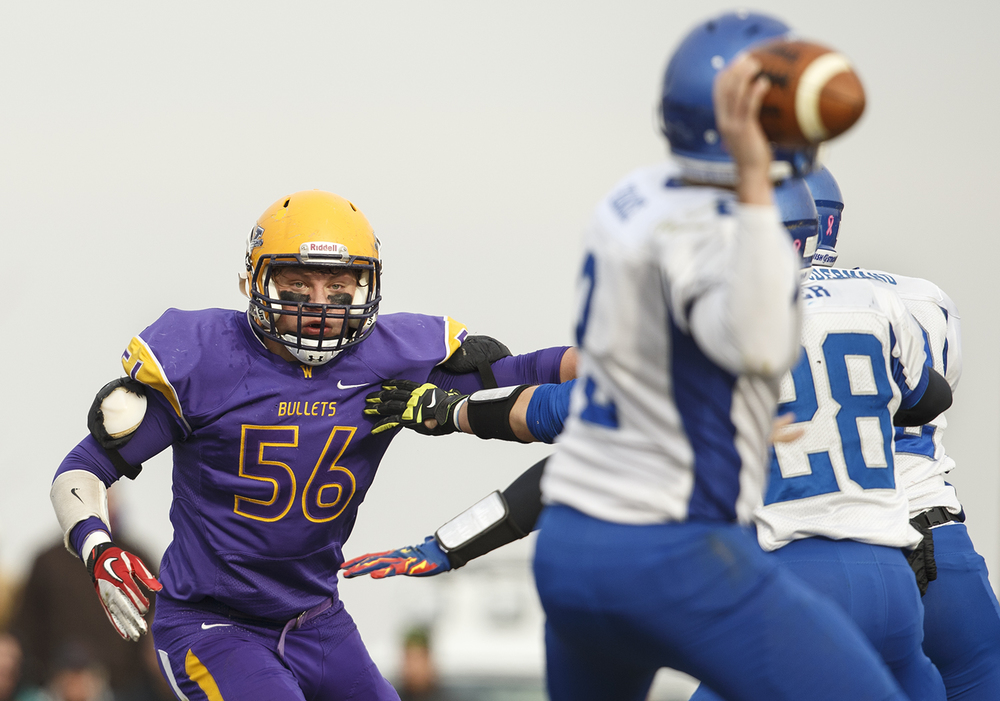Williamsville's Riley Perrine eyes Auburn quarterback Drew Chance as he winds up to throw during the Class 3A high school football playoffs in Williamsville Saturday, Nov. 15, 2014. Ted Schurter/The State Journal-Register