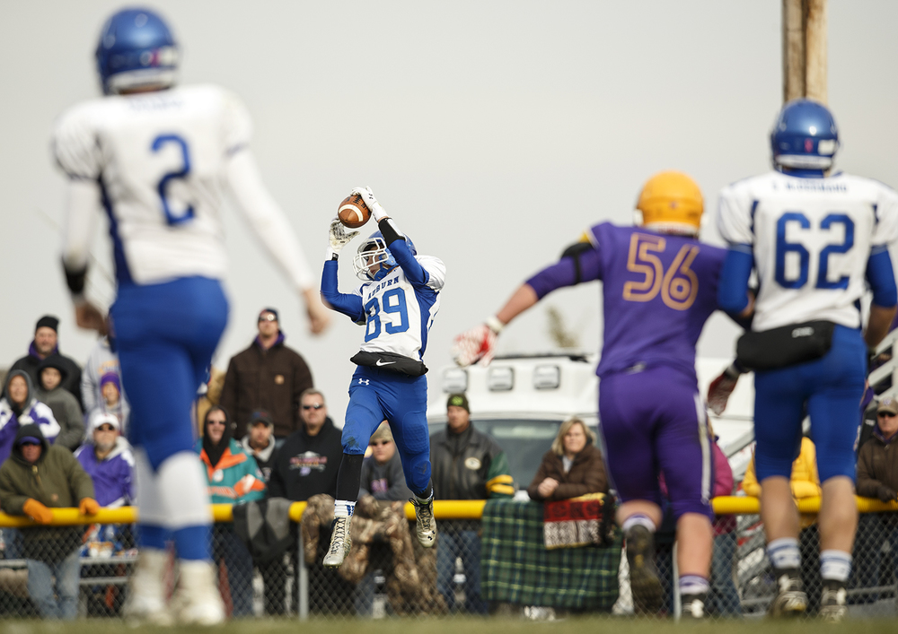 Auburn's Everett Stevens grabs a pass in the open field against Williamsville during the Class 3A high school football playoffs in Williamsville Saturday, Nov. 15, 2014. Ted Schurter/The State Journal-Register