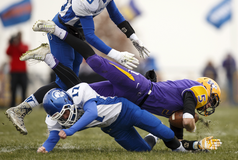 Auburn's Michael Ricker and Everett Stevens bring down Williamsville's Vince Vignali during the Class 3A high school football playoffs in Williamsville Saturday, Nov. 15, 2014. Ted Schurter/The State Journal-Register