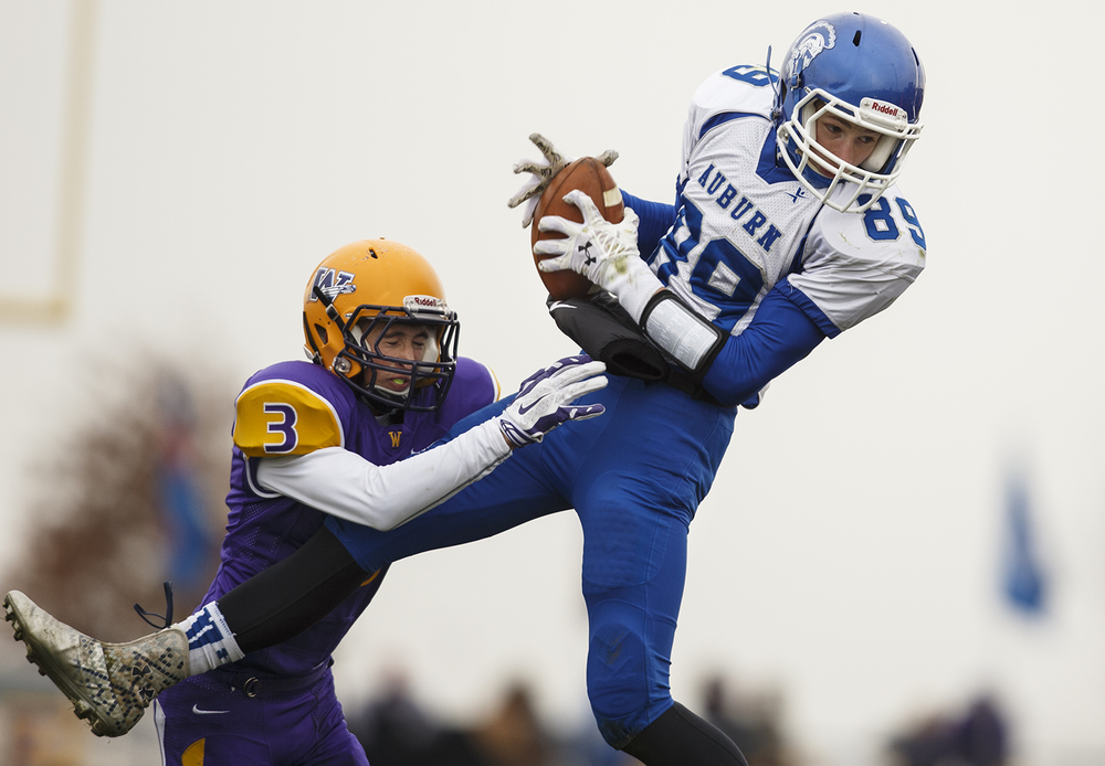 Auburn's Everett Stevens grabs a pass and a first down in front of Williamsville's Ben Kovacevich during the Class 3A high school football playoffs in Williamsville Saturday, Nov. 15, 2014. Ted Schurter/The State Journal-Register