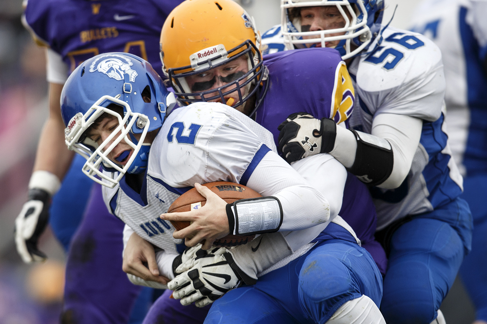 Williamsville's Alec Daykin sacks Auburn's Drew Chance during the Class 3A high school football playoffs in Williamsville Saturday, Nov. 15, 2014. Ted Schurter/The State Journal-Register