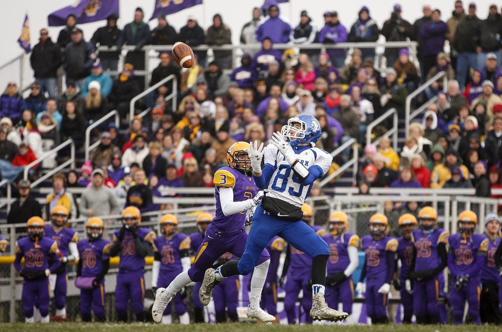 Auburn's Everett Stevens hauls in a long pass on the first play from scrimmage against Williamsville during the Class 3A high school football playoffs in Williamsville Saturday, Nov. 15, 2014. Ted Schurter/The State Journal-Register