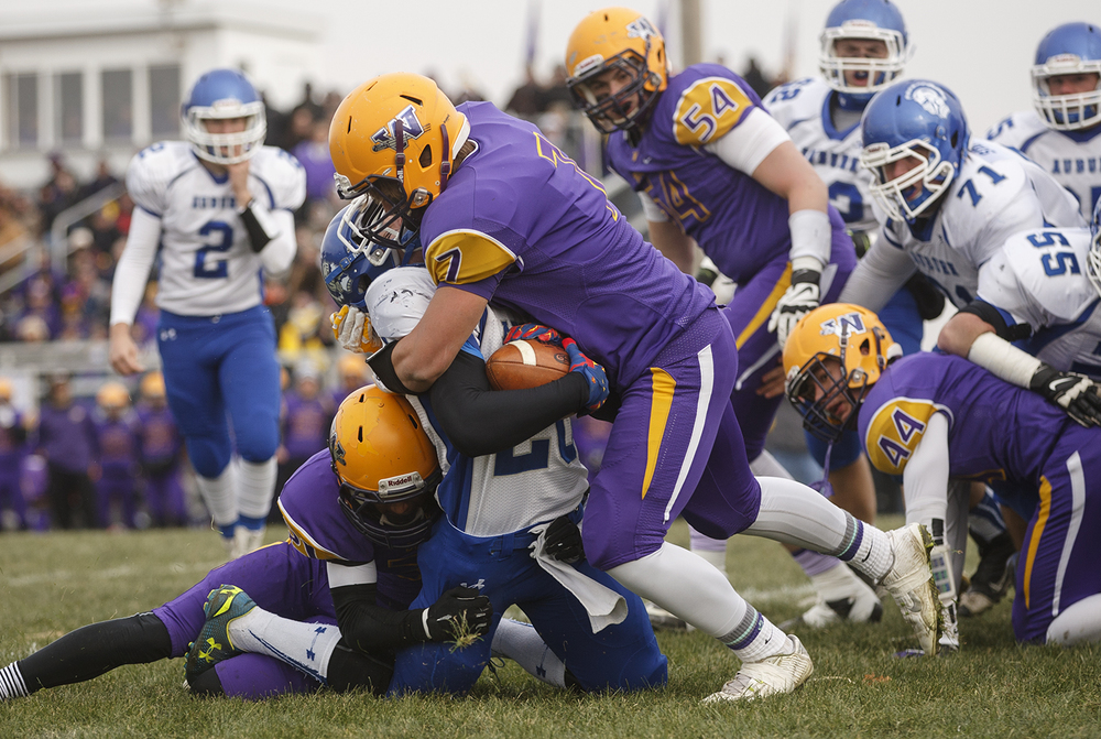 Auburn's Noah Meyer is tackled by Williamsville's M.J. Haire during the Class 3A high school football playoffs in Williamsville Saturday, Nov. 15, 2014. Ted Schurter/The State Journal-Register