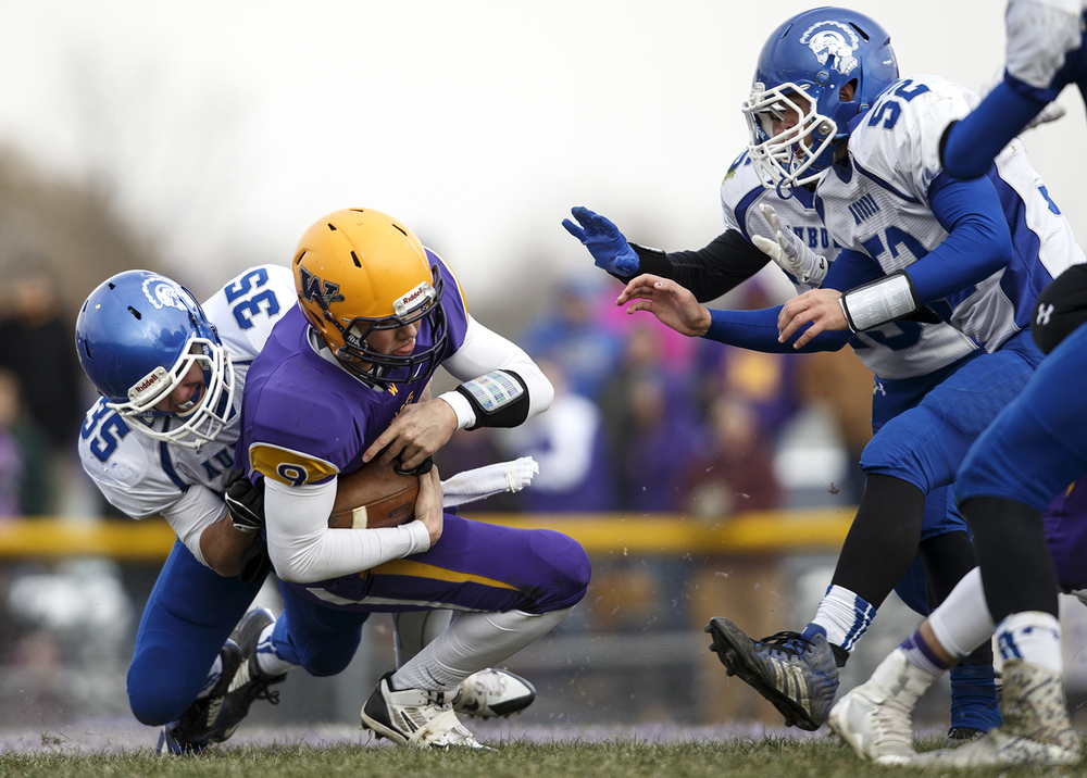 Auburn's Colton McDannald brings down Williamsville quarterback Luke Bleyer during the Class 3A high school football playoffs in Williamsville Saturday, Nov. 15, 2014. Ted Schurter/The State Journal-Register