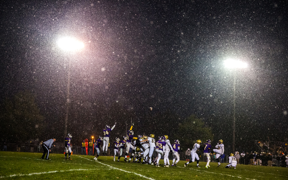 Sacred Heart-Griffin's Cody Bowman (52) kicks an extra point in the snow against Taylorville in the second half during the Class 5A quarterfinal playoffs at Taylorville High School, Saturday, Nov. 15, 2014, in Taylorville, Ill. Justin L. Fowler/The State Journal-Register