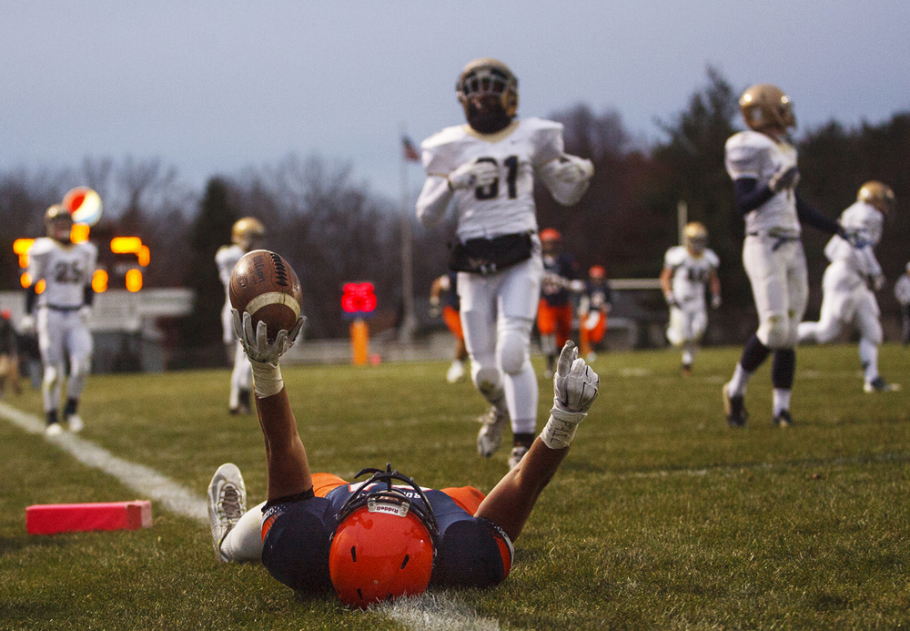 Rochester's Evan Sembell celebrates his touchdown against Bloomington Central Catholic during the Class 4A high school football playoffs at Rocket Booster Stadium Saturday, Nov. 15, 2014. Ted Schurter/The State Journal-Register