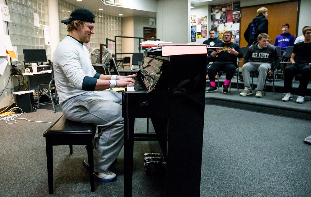 Williamsville senior defensive end Riley Perrine plays the piano as the team gathers to watch a video in the choir room with messages of inspiration from players from previous years at Williamsville High School, Friday, Nov. 14, 2014, in Williamsville, Ill. Justin L. Fowler/The State Journal-Register