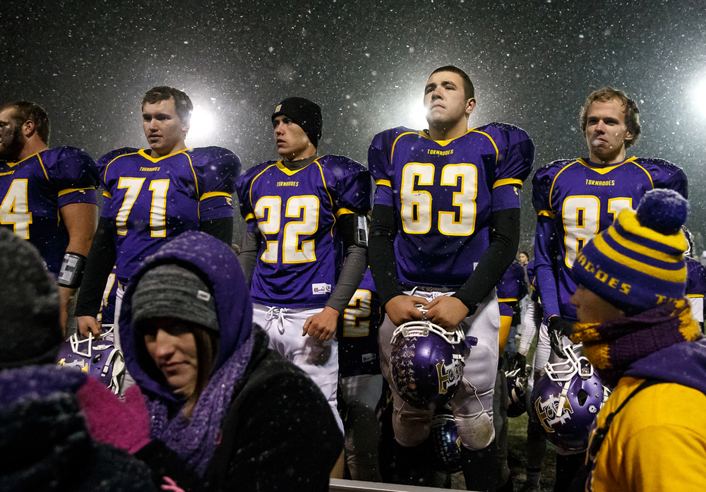 Taylorville's Elliot Hogge (63) stands on the bleachers with his fellow seniors as the crowd cheers for them after their 63-14 loss to Sacred Heart-Griffin during the Class 5A quarterfinal playoffs at Taylorville High School, Saturday, Nov. 15, 2014, in Taylorville, Ill. Justin L. Fowler/The State Journal-Register