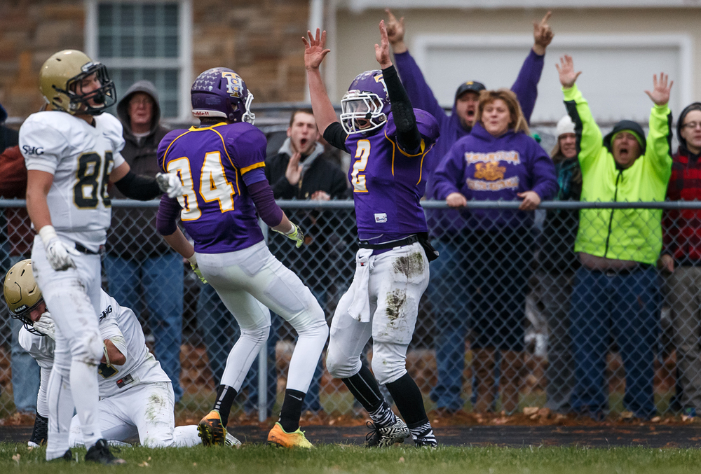 Taylorville quarterback Tanner Champley (4) celebrates his touchdown against Sacred Heart-Griffin with Cole Owens (84) in the first half during the Class 5A quarterfinal playoffs at Taylorville High School, Saturday, Nov. 15, 2014, in Taylorville, Ill. Justin L. Fowler/The State Journal-Register