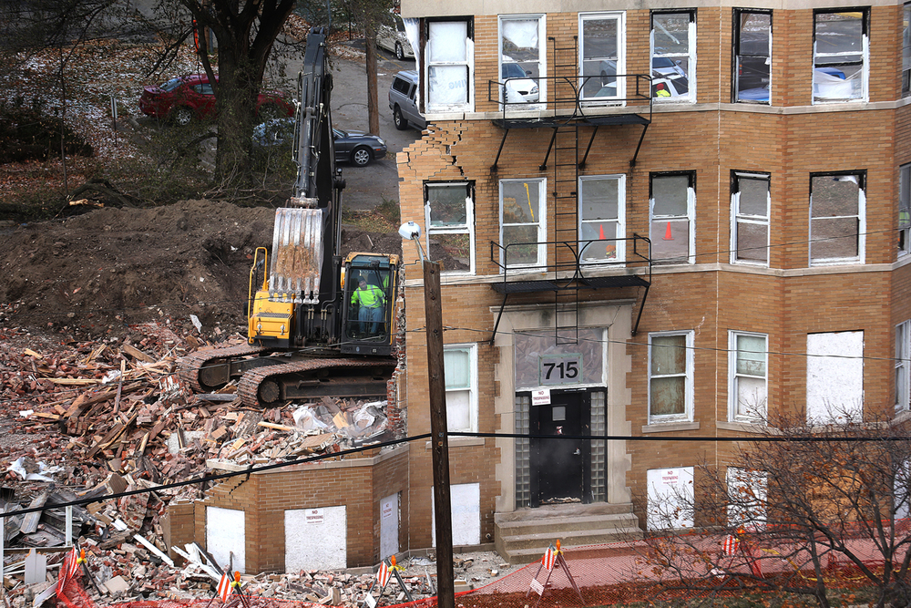The facade of the Knox Flats apartment at 715 E. Cook St is the last part to go down when the building was razed Tuesday, Nov. 18, 2014. The City of Springfield plans to file a lien on the property to recoup the cost of demolition after owner John Egalston, who purchased the building in 2008, failed to fix or demolish the building himself. David Spencer/The State Journal-Register