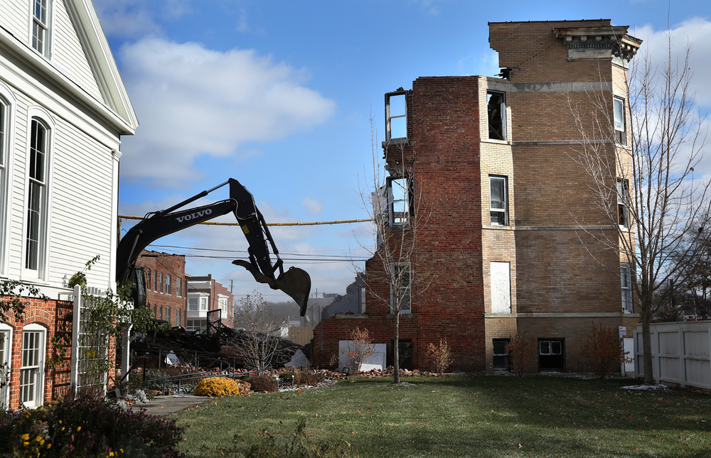A view showing the demolition in progress with the Elijah Iles House at left. Public Works department employees from the city of Springfield demolished the Knox Flats building at 715 E. Cook St. in Springfield on Tuesday, Nov. 18, 2014. David Spencer/The State Journal-Register