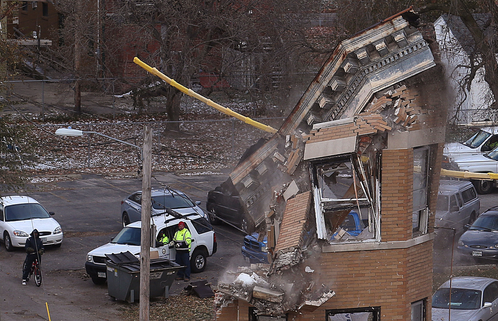 An upper section of the facade comes down. Public Works department employees from the city of Springfield demolished the Knox Flats building at 715 E. Cook St. in Springfield on Tuesday, Nov. 18, 2014. David Spencer/The State Journal-Register
