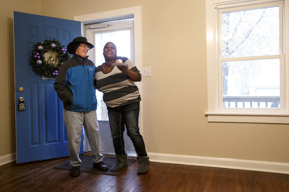 Steve Rambach gives Thomas a parting hug after the home dedication Sunday, Nov. 16, 2014. Rambach, Thomas' former teacher at Lanphier High School, serves on the board at Habitat for Humanity and made the call informing her of her selection to receive the house.  Ted Schurter/The State Journal-Register