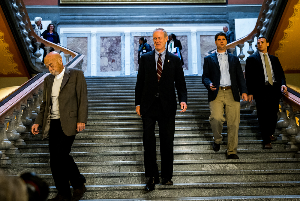 Governor-Elect Bruce Rauner heads down the steps on his way to a press conference at the Illinois State Capitol, Thursday, Nov. 20, 2014, in Springfield, Ill. Justin L. Fowler/The State Journal-Register