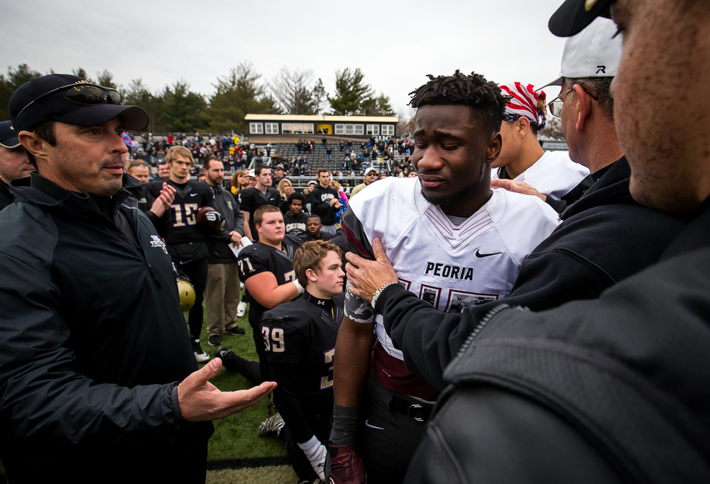 Peoria Central's BJ Harris (45) and his teammates came over to shake hands with the Cyclones after tempers flared and canceled the post game handshake after the Lions were defeated 49-21 in the semifinals of the Class 5A playoffs at the SHG Sports Complex, Saturday, Nov. 22, 2014, in Springfield, Ill. Justin L. Fowler/The State Journal-Register