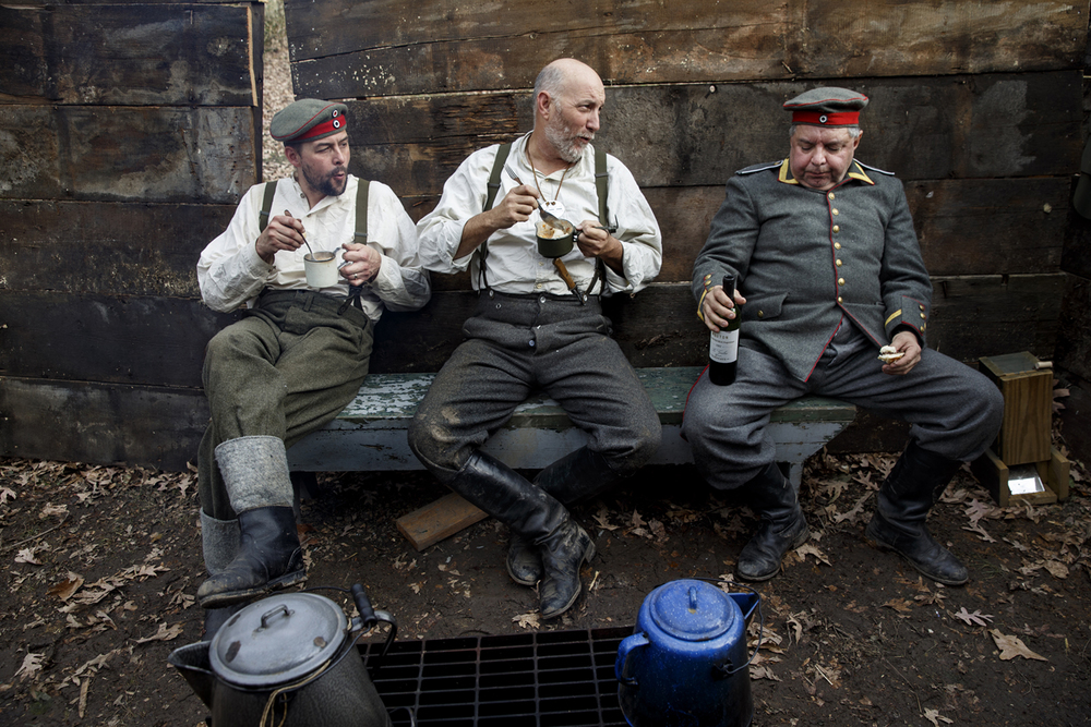 German 353 Infantry re-enactors Erik Hack, left, Lawrence Johnson and William Larsen eat together as they wait for the next skirmish at the Great War Encampment at the Illinois State Military Museum Saturday, Nov. 22, 2014.   Ted Schurter/The State Journal-Register