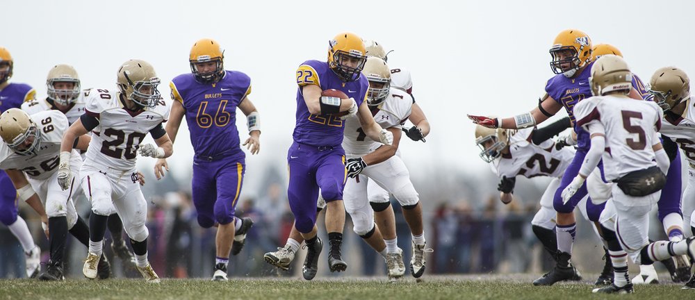 Williamsville's Tate Manka breaks through a big hole as he runs the ball against Mt. Carmel during the Class 3A high school football playoffs in Williamsville Saturday, Nov. 22, 2014. Ted Schurter/The State Journal-Register