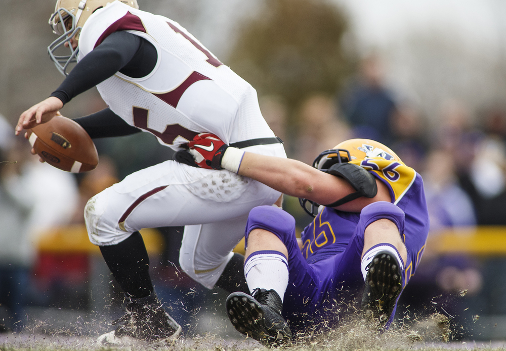 Williamsville's Riley Perrine brings down Mt. Carmel quarterback Pete Smith during the Class 3A high school football playoffs in Williamsville Saturday, Nov. 22, 2014. Ted Schurter/The State Journal-Register