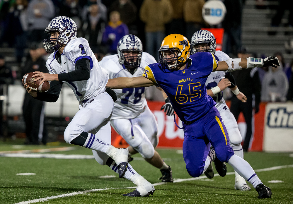 Williamsville's John Karras (65) flushes Wilmington quarterback Mason Southall (1) out of the pocket and brings him down in the second half during the IHSA Class 3A state championship game at Memorial Stadium, Friday, Nov. 28, 2014, in Champaign, Ill. Justin L. Fowler/The State Journal-Register