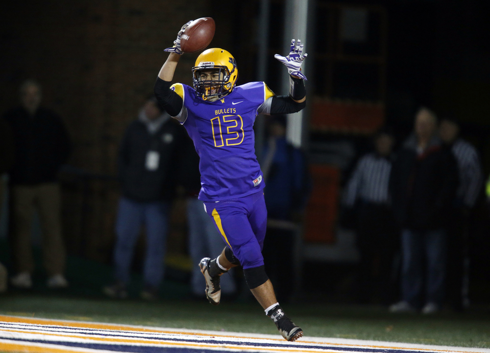 Williamsville's Jace Franklin celebrates his touchdown against Wilmington during the Class 3A football championship game at Memorial Stadium Friday, Nov. 28, 2014. Ted Schurter/The State Journal-Register