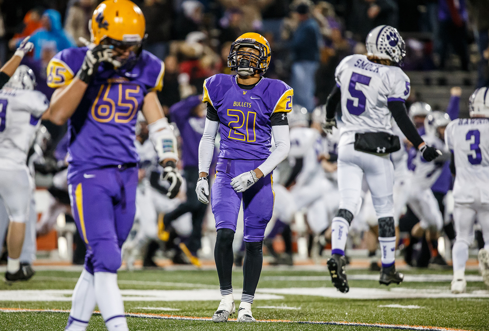 Williamsville's Avante' Cox (21) reacts after the Bullets were defeated by Wilmington 20-17 in the IHSA Class 3A state championship game at Memorial Stadium, Friday, Nov. 28, 2014, in Champaign, Ill. Justin L. Fowler/The State Journal-Register