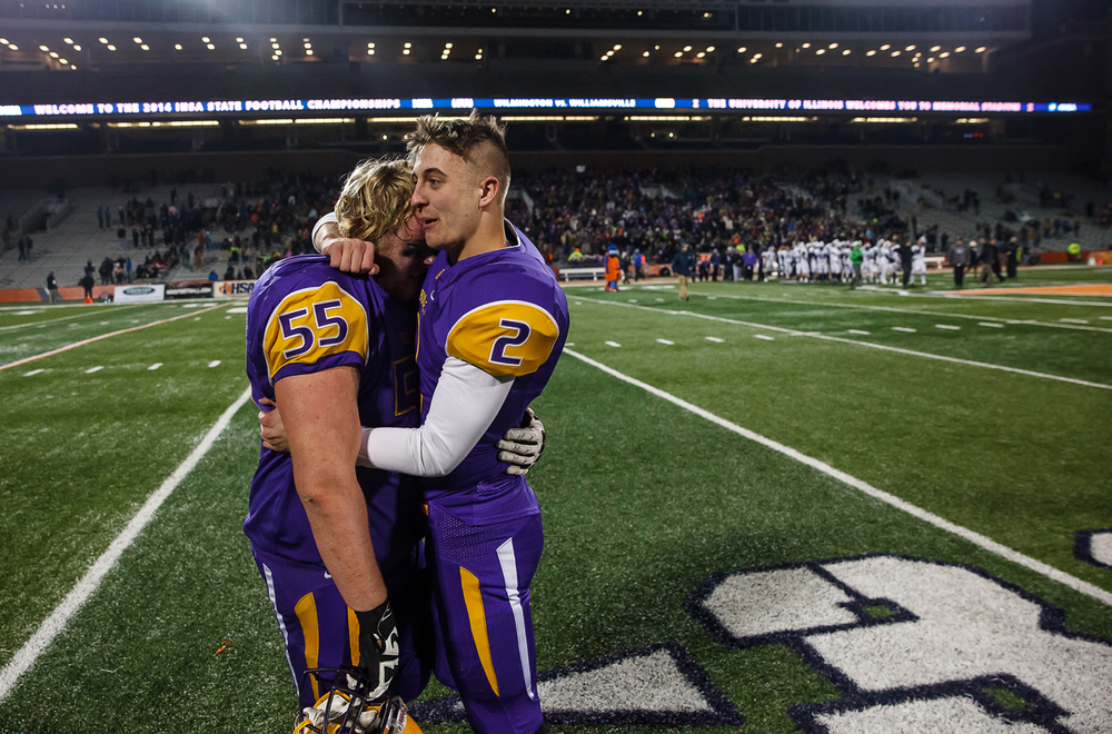 Williamsville's Cole Courson (2) comforts Alec Daykin (55) after the Bullets were defeated by Wilmington 20-17 in the IHSA Class 3A state championship game at Memorial Stadium, Friday, Nov. 28, 2014, in Champaign, Ill. Justin L. Fowler/The State Journal-Register