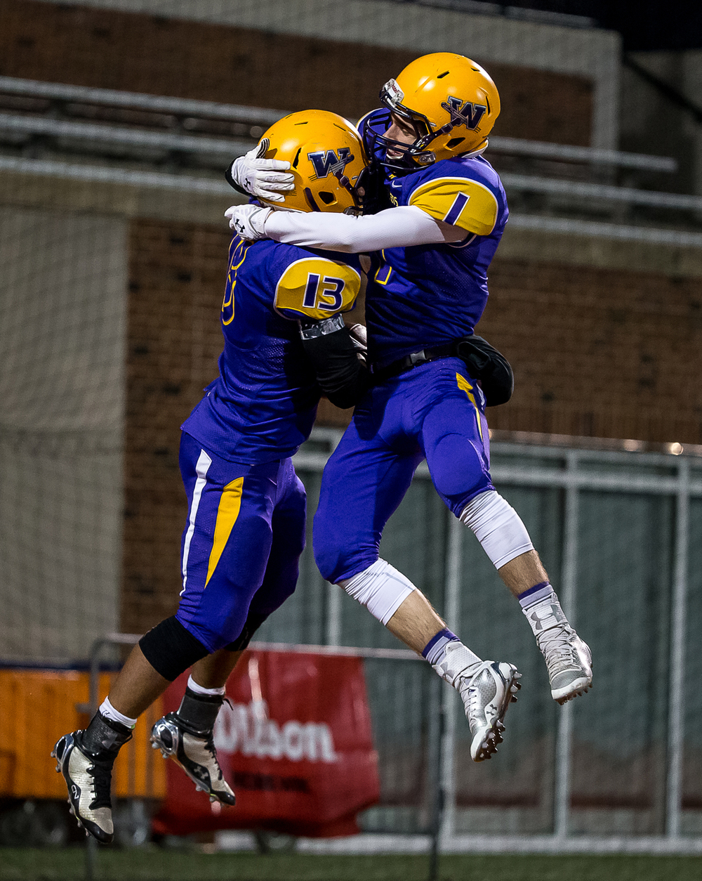 Williamsville's Jace Franklin (13) celebrates his 65-yard touchdown with Williamsville's Daniel Daykin (1) to tie the game against Wilmington in the second half during the IHSA Class 3A state championship game at Memorial Stadium, Friday, Nov. 28, 2014, in Champaign, Ill. Justin L. Fowler/The State Journal-Register