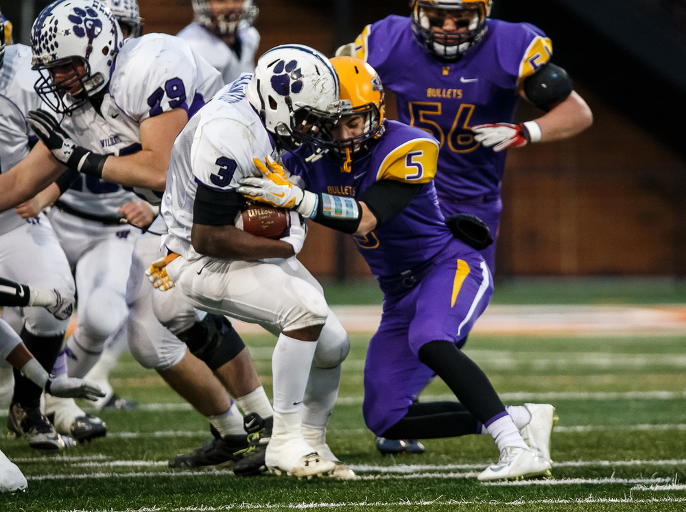 Williamsville's Vince Vignali (5) gets a stop on Wilmington's Nick Hawkins (3) on a rush in the first half during the IHSA Class 3A state championship game at Memorial Stadium, Friday, Nov. 28, 2014, in Champaign, Ill. Justin L. Fowler/The State Journal-Register
