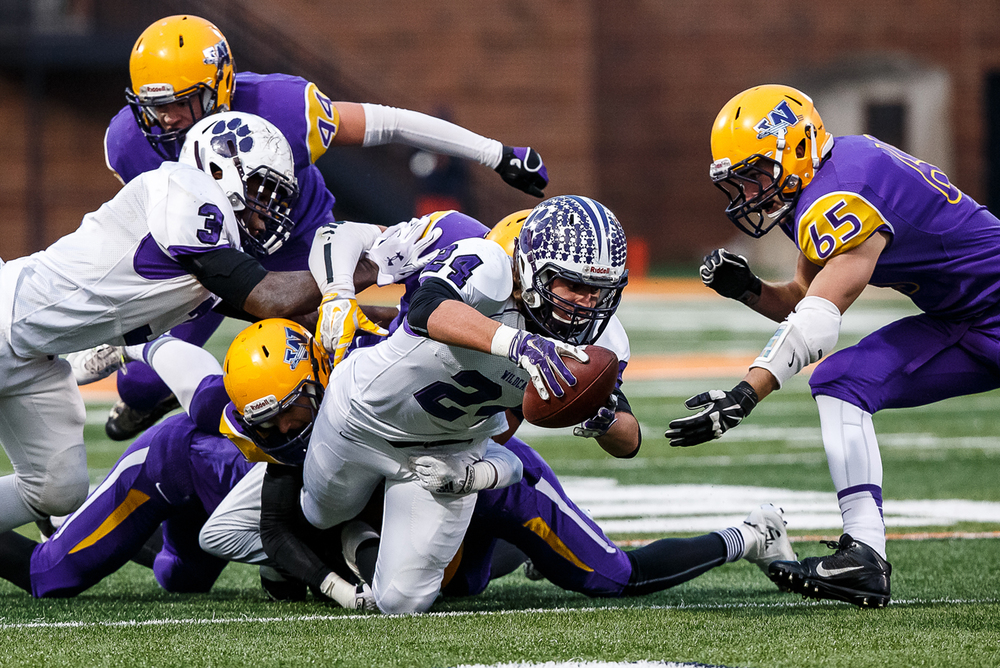 Wilmington's Alex Zlomie (24) gets stopped on a fourth and five by the Williamsville defense in the first half during the IHSA Class 3A state championship game at Memorial Stadium, Friday, Nov. 28, 2014, in Champaign, Ill. Justin L. Fowler/The State Journal-Register