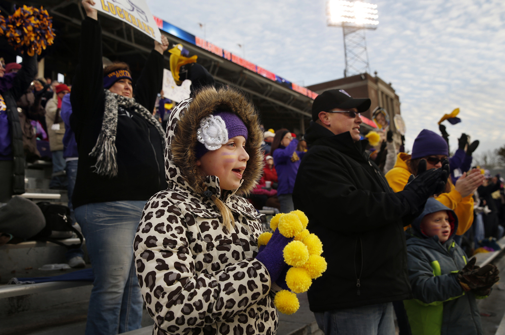 Williamsville fan Aubrey Kirkman cheers for the Bullets as they enter the stadium to face Wilmington during the Class 3A football championship game at Memorial Stadium Friday, Nov. 28, 2014. Ted Schurter/The State Journal-Register
