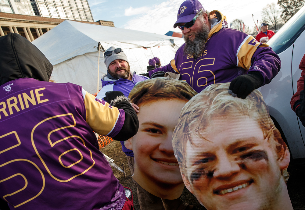 Bob Perrine, right, gets out the cardboard cutouts of his sons, Williamsville's Reese Perrine (60) and Riley Perrine (56) prior to WIliamsville taking on Wilmington in the IHSA Class 3A state championship game at Memorial Stadium, Friday, Nov. 28, 2014, in Champaign, Ill. Justin L. Fowler/The State Journal-Register