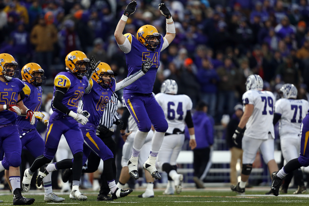 Williamsville's Mitch Whitley and the Bullets celebrate a defensive stop against Wilmington during the Class 3A football championship game at Memorial Stadium Friday, Nov. 28, 2014. Ted Schurter/The State Journal-Register