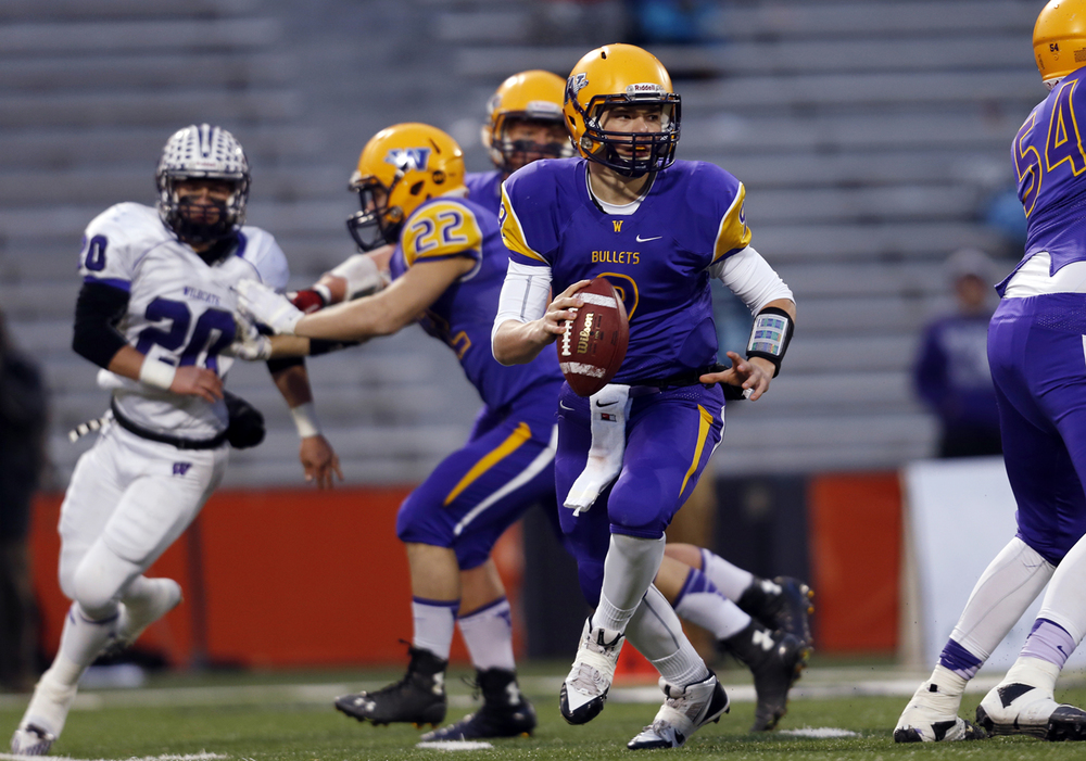 Williamsville's Luke Bleyer scrambles out of the pocket against Wilmington during the Class 3A football championship game at Memorial Stadium Friday, Nov. 28, 2014. Ted Schurter/The State Journal-Register