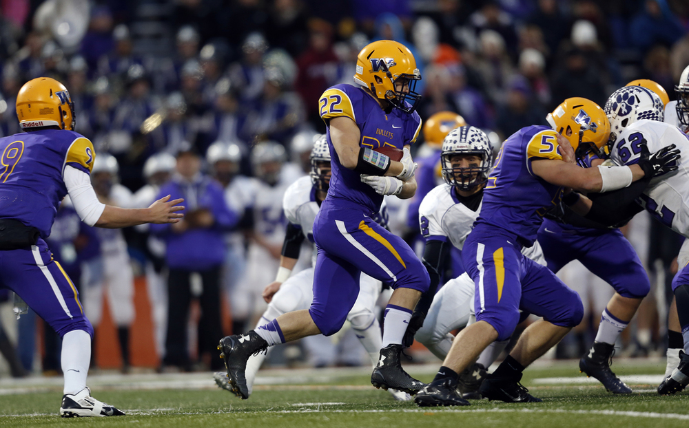 Williamsville quarterback Luke Bleyer hands the ball off to Tate Manka during the Class 3A football championship game at Memorial Stadium Friday, Nov. 28, 2014. Ted Schurter/The State Journal-Register