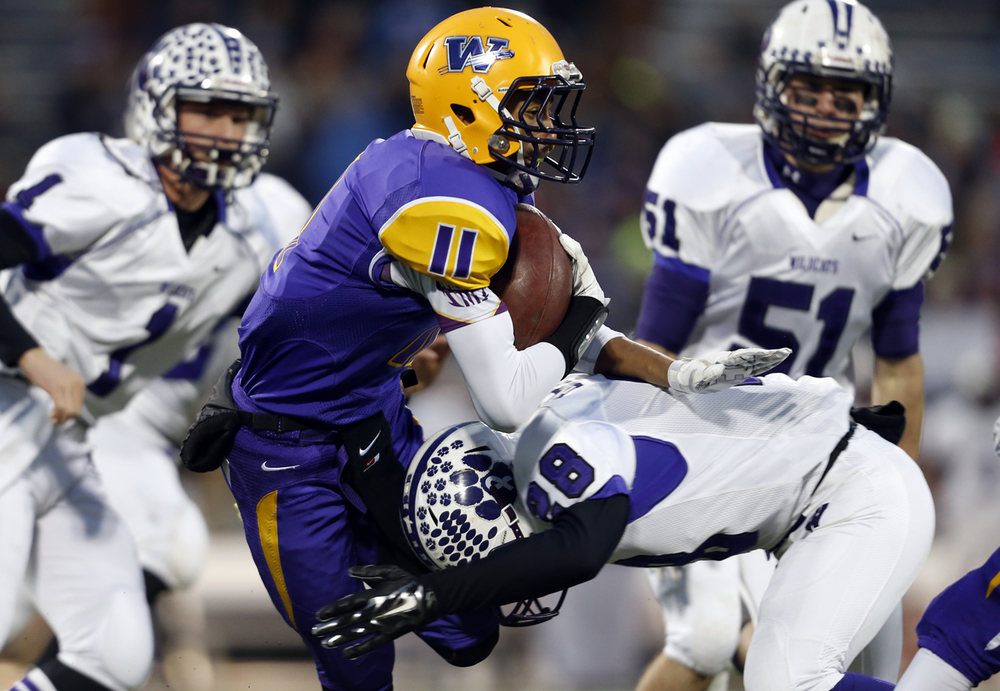 Williamsville's D'ante' Cox is tackled by Wilmington's Tyler Brimer during the Class 3A football championship game at Memorial Stadium Friday, Nov. 28, 2014. Ted Schurter/The State Journal-Register