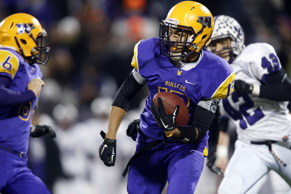 Williamsville's Jace Franklin runs the ball agaisnt Wilmington during the Class 3A football championship game at Memorial Stadium Friday, Nov. 28, 2014. Ted Schurter/The State Journal-Register